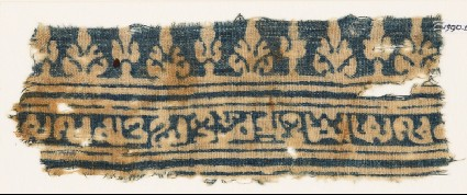 Textile fragment with inscription, lines, stylized palmettes, and possibly treesfront
