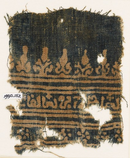 Textile fragment with inscription, rosettes, and stylized trees and palmettesfront