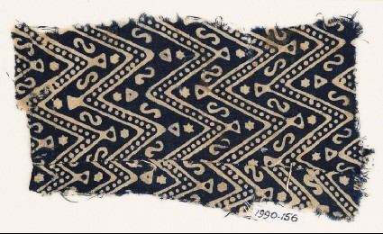 Textile fragment with large chevrons, dots, S-shapes, and starsfront