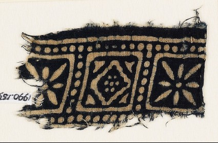 Textile fragment with squares, rosettes, and a diamond-shapefront