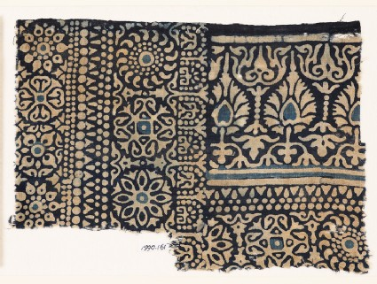Textile fragment with rosettes, arches, stylized trees or flowers, and leavesfront
