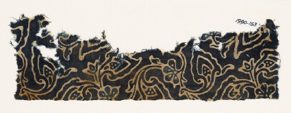 Textile fragment with swirling flower-heads and leavesfront