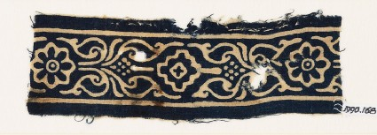 Textile fragment with rosettes, stylized leaves, and a diamond-shapefront