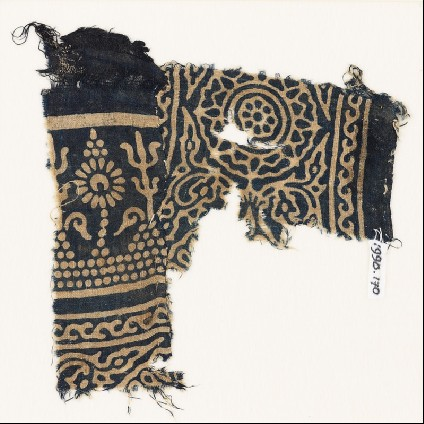 Textile fragment with stylized trees and flowers, a rosette, and leavesfront