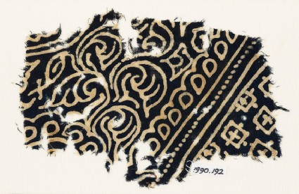 Textile fragment with swirling tendrils, tear-drops, and squaresfront