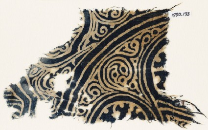 Textile fragment with swirling tendrilsfront