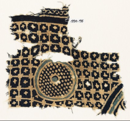 Textile fragment with grid, stars, and a circle with dotsfront