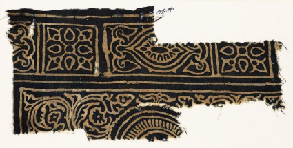Textile fragment with squares with quatrefoils, rectangles, and swirling tendrilsfront