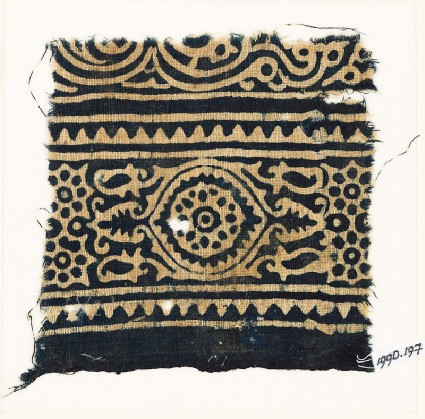 Textile fragment with medallion, and rosettes set into linked starsfront
