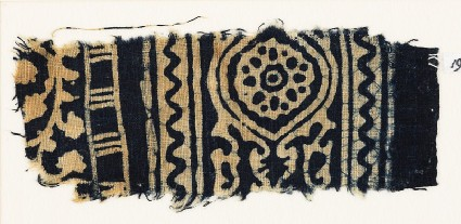 Textile fragment with medallion, and a vine with leaves and flowersfront
