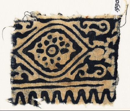 Textile fragment with medallion, flower, and tendrilsfront