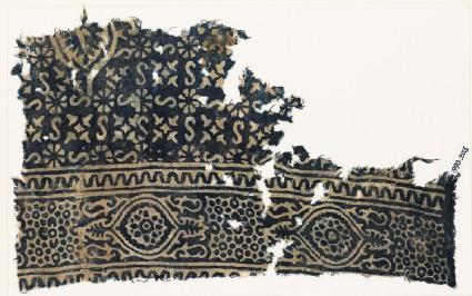 Textile fragment with S-shapes, quatrefoils, and rosettes set into linked starsfront