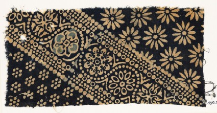 Textile fragment with ornate, dotted, and large rosettesfront