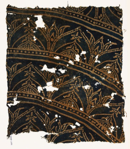 Textile fragment with arches and plantsfront