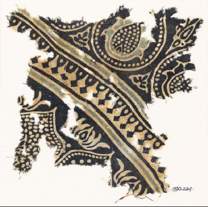 Textile fragment with tear-drops and stylized flower-headsfront