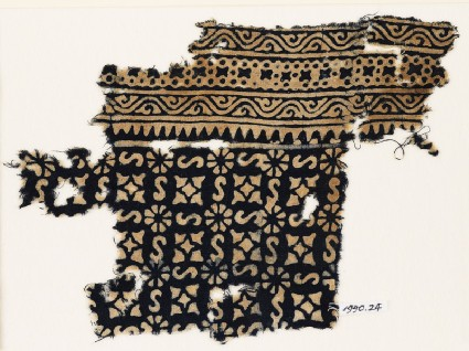Textile fragment with S-shapes, rosettes, and quatrefoilsfront