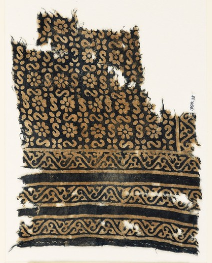 Textile fragment with S-shapes, rosettes, and flowersfront