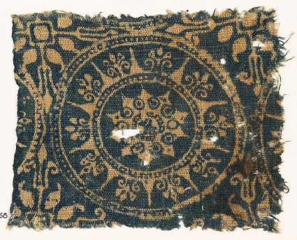 Textile fragment with medallion and starsfront