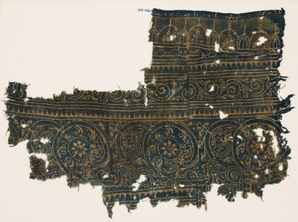 Textile fragment with linked scrollsfront