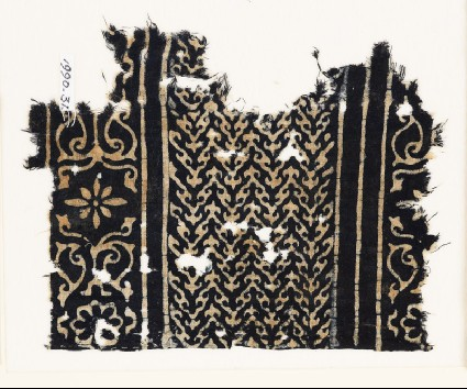 Textile fragment with linked chevrons, flowers, and leavesfront
