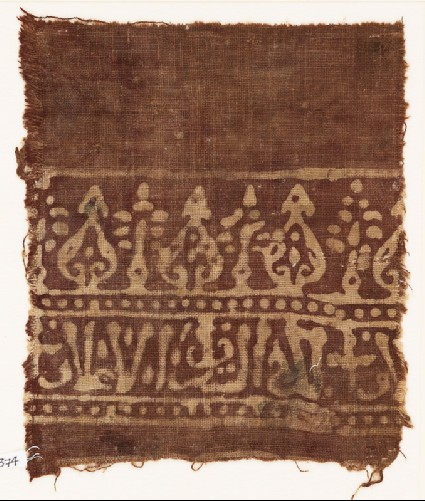 Textile fragment with stylized trees and scriptfront
