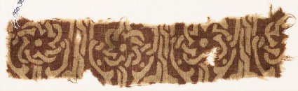 Textile fragment with interlace forming flower-shapesfront