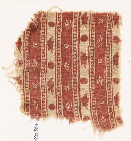 Textile fragment with bands of flowers and circlesfront