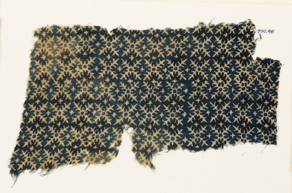 Textile fragment with serrated crossesfront