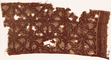 Textile fragment with interlocking spirals or rosettesfront
