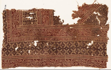 Textile fragment with bands of vines and serrated crossesfront