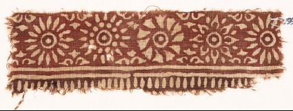 Textile fragment with band of rosettesfront
