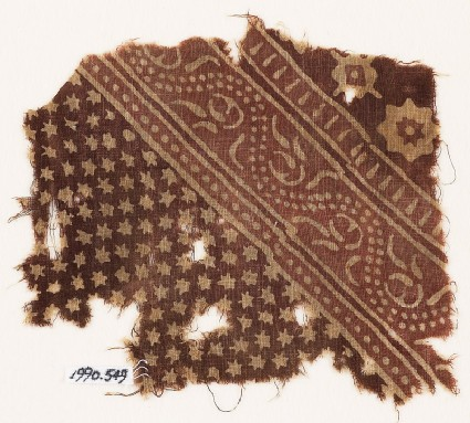 Textile fragment with small and large stars, and a dotted vinefront