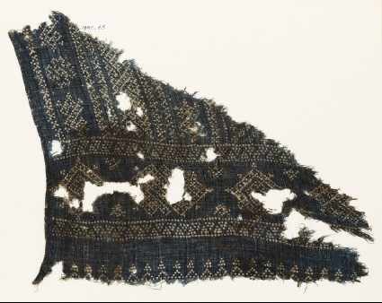 Textile fragment with geometric patterns, diamond-shapes, and zigzags made of dotsfront