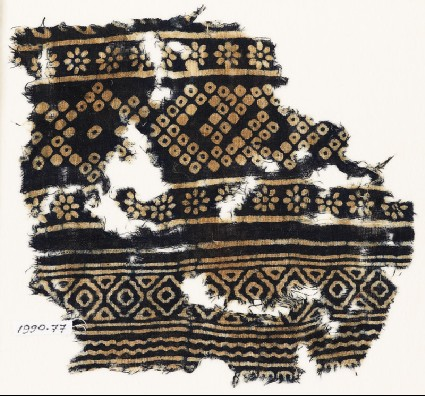 Textile fragment with rosettes and bandhani, or tie-dye, imitationfront