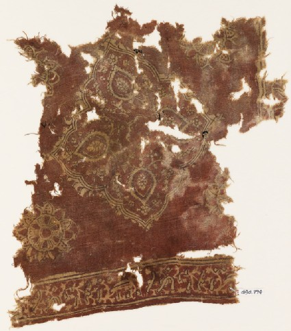 Textile fragment with floral medallion and Persian-style scriptfront