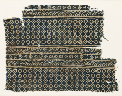 Textile fragment with diamond-shapes, lobed squares, and dotsfront