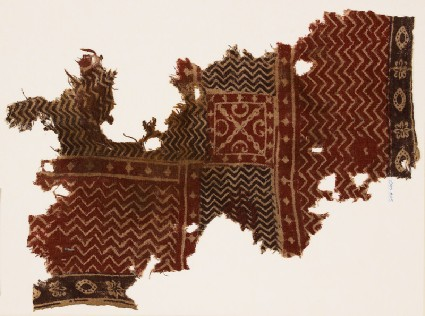 Textile fragment with chevrons and a squarefront
