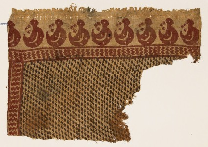 Textile fragment with S-shapes and crescentsfront