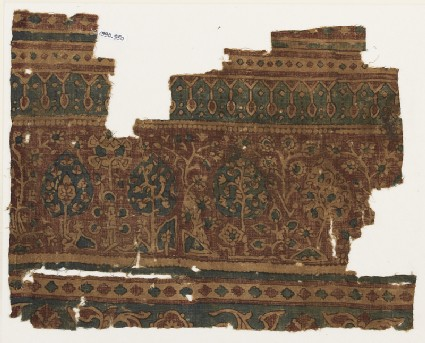 Textile fragment with flowering treesfront