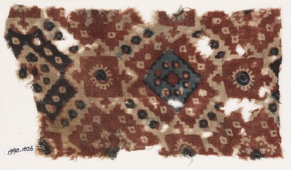 Textile fragment probably imitating patola pattern, with diamond-shapes and squaresfront