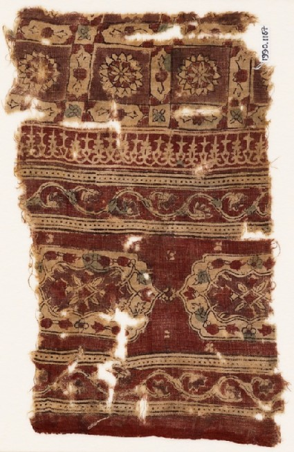 Textile fragment with elongated hexagons, vines, and linked squaresfront