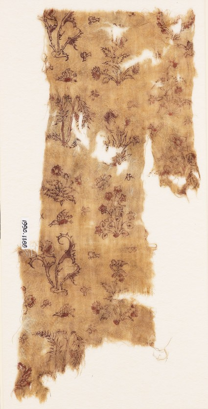 Textile fragment with flowering plants, birds, and insectsfront