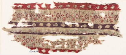 Textile fragment with bands of flowersfront