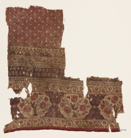 Textile fragment with flower bushesfront