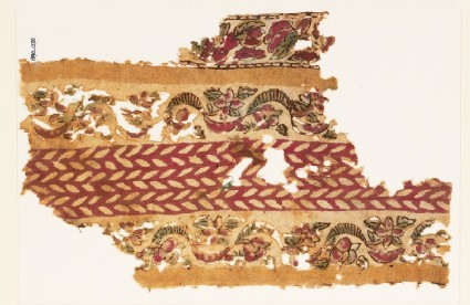 Textile fragment with bands of linked flowers and leavesfront