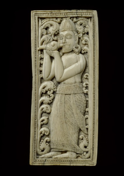 Ivory plaque with conch-blowerfront