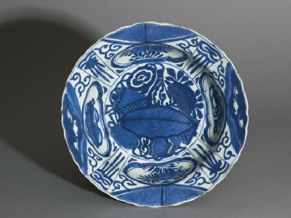 Blue-and-white kraak style bowl with banana leaf and flowerstop
