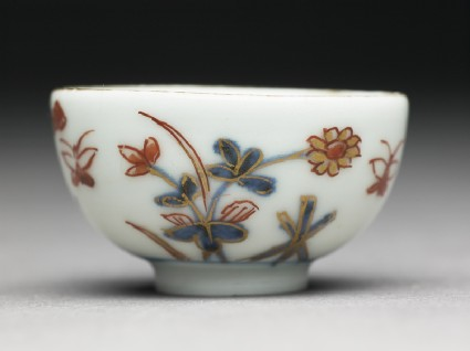 Miniature cup with flowers and butterfliesside