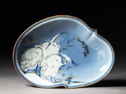 Dish with three egretstop
