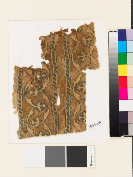 Textile fragment with bands of curving lines and floral trefoilsfront